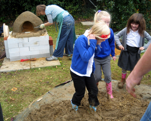 Treading the mix for the Earth Oven