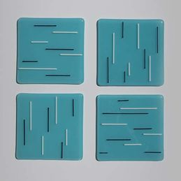 light blue, white and black coasters