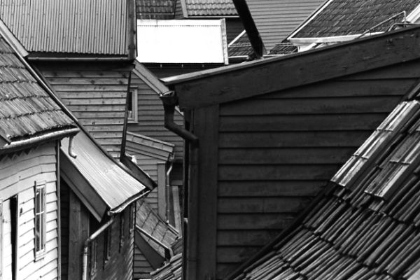 black and white photographic art of historic buildings and architecture of the UNESCO heritage site of Bryggen in Bergen Norway