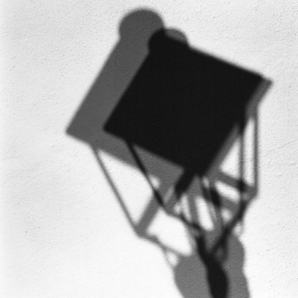 abstract black and white photographic art of lamppost shadows in Mijas Spain