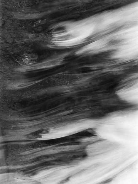 abstract black and white photographic nature art of water flowing at dams along the Grand River in Ontario