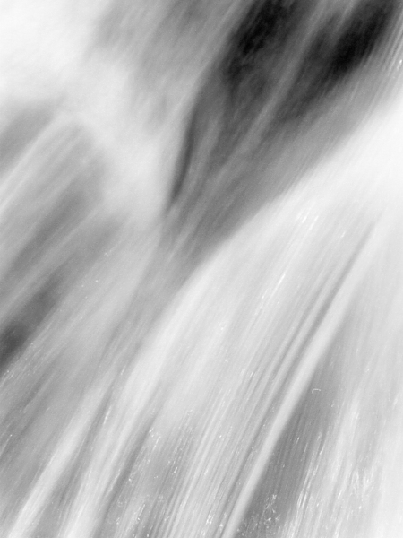 abstract black and white photographic art of water flowing at dams along the Grand River in Ontario