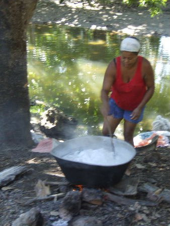 Boiling laundry on river bank
