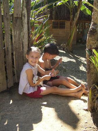 Village children with pet dog