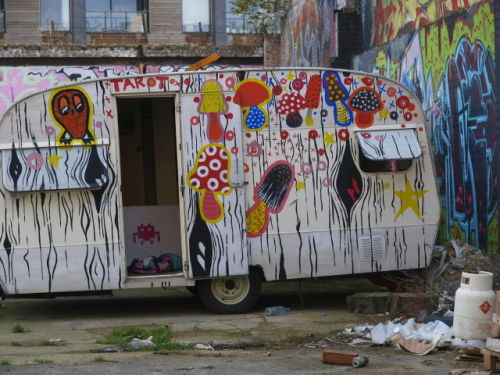 Caravan with graffiti