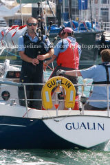 Contessa 32 Class, Gualin, sailor playing the bagpipes after a day sailing at Cowes 2013