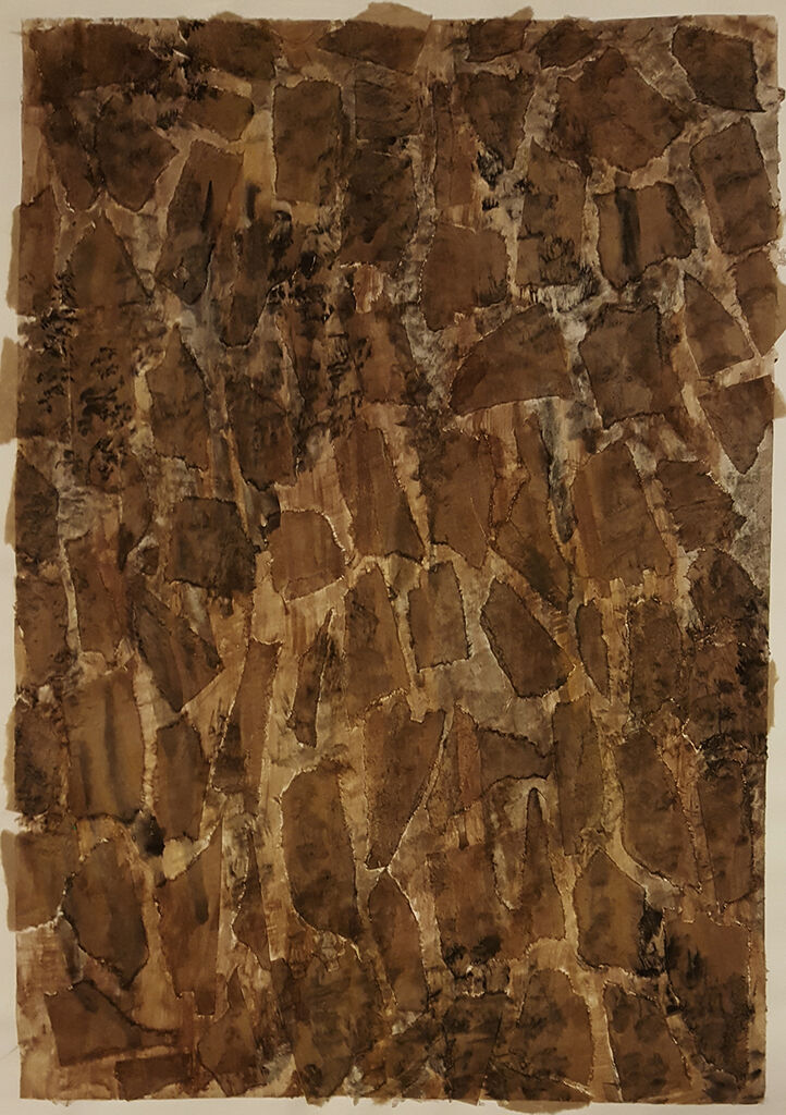 a portrait-format  abstract made of torn paper, stained brown with paint and rubbed with charcoal to create a rough surface