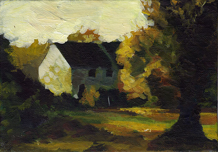 a small white house with a dark roof sits half-hidden beside green-gold autumn foliage. it is strongly lit from the side, with the front in shadow. a tree stands in the foreground.