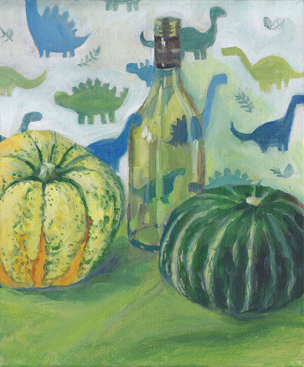two gourds and a green glass bottle sit against a backdrop of dinosaur-patterned paper