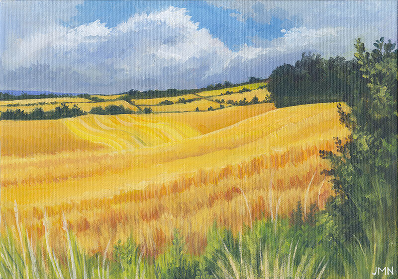 a painting of golden wheat fields in the sun, with hedgerows visible in the distance. there is a blue sky with puffy white clouds overhead, and a row of green grass and weeds in the foreground.
