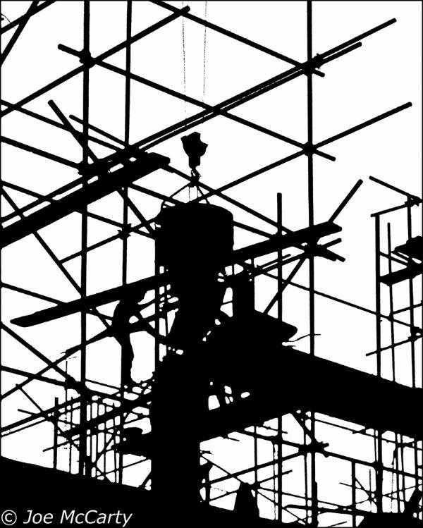 Building worker pouring concrete