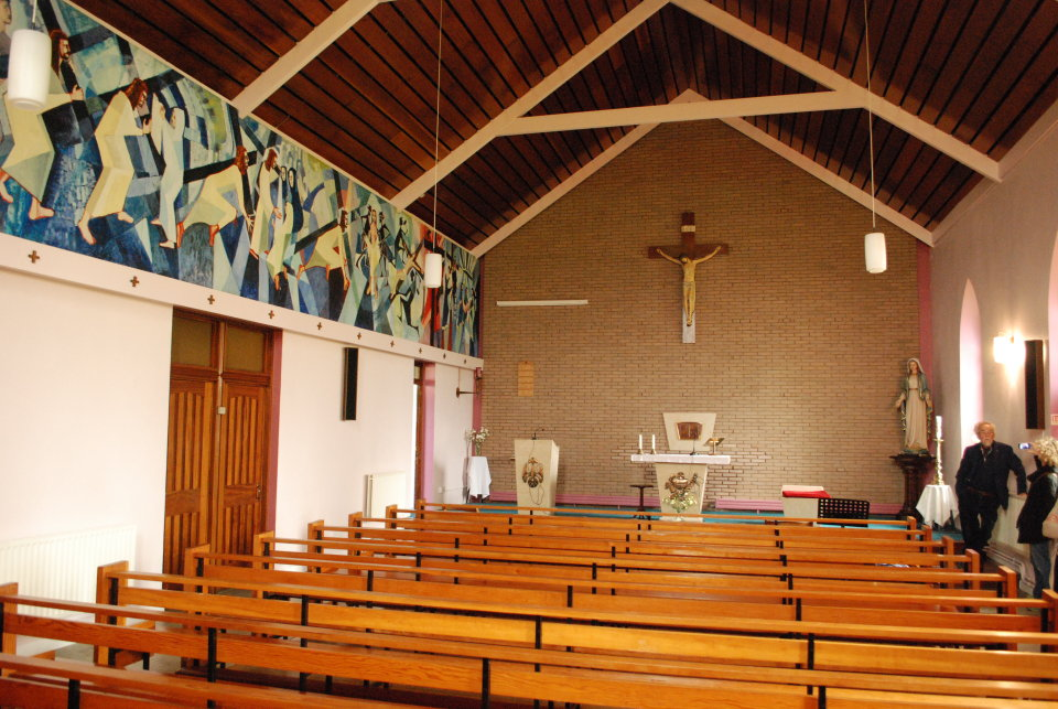 Interior shot of St Marys Church with Stations of the Cross.