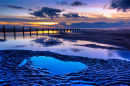 Blackpool, shallow pools in the sand at dusk