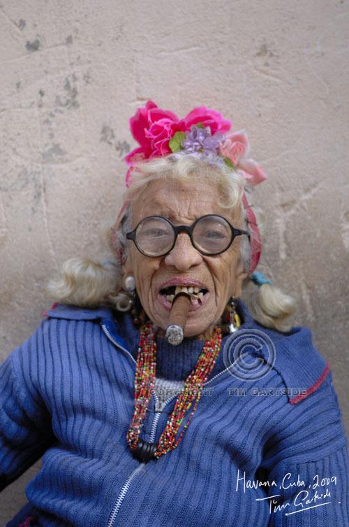 Old woman smoking Havana Cigar
