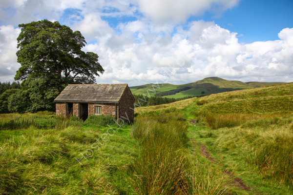 An old Barn with Shutlingsloe Hill in the distance at Cheshire England UK