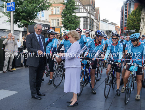 Lady gretton cuts the tape to send the cyclists on their way