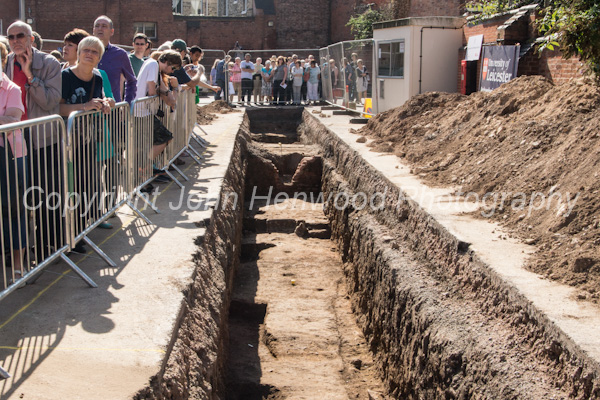 Members of the public view the trenches dug during the dig