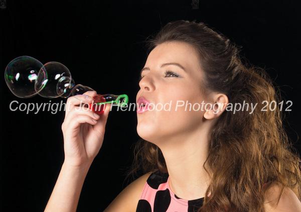 Bella blowing bubbles