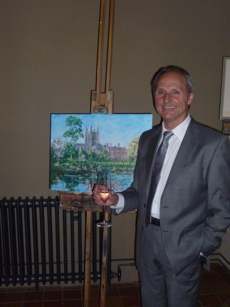 Myself in front of my painting that I donated for auction to raise money for the charity Funny Blood