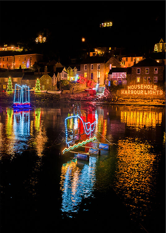 Mousehole harbour at Christmas.