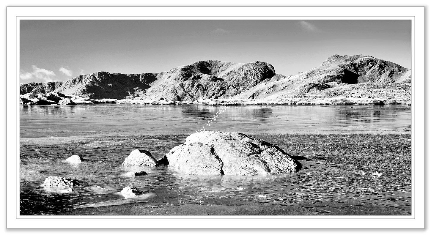 Scafell over a frozen Three Tarns