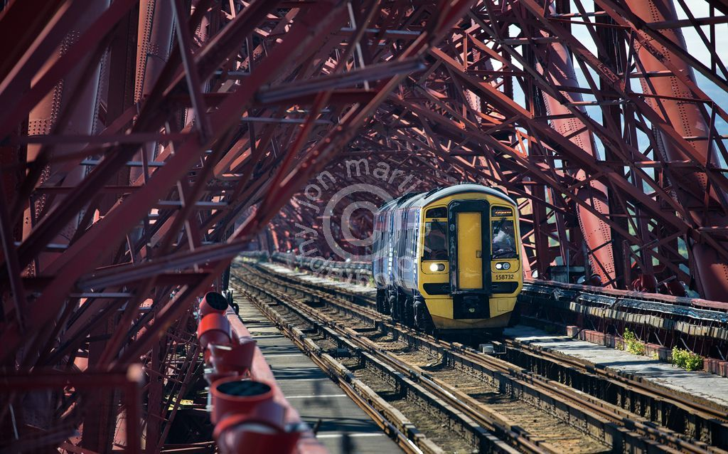 Train on the Forth Bridge at Ground Level, Edinburgh