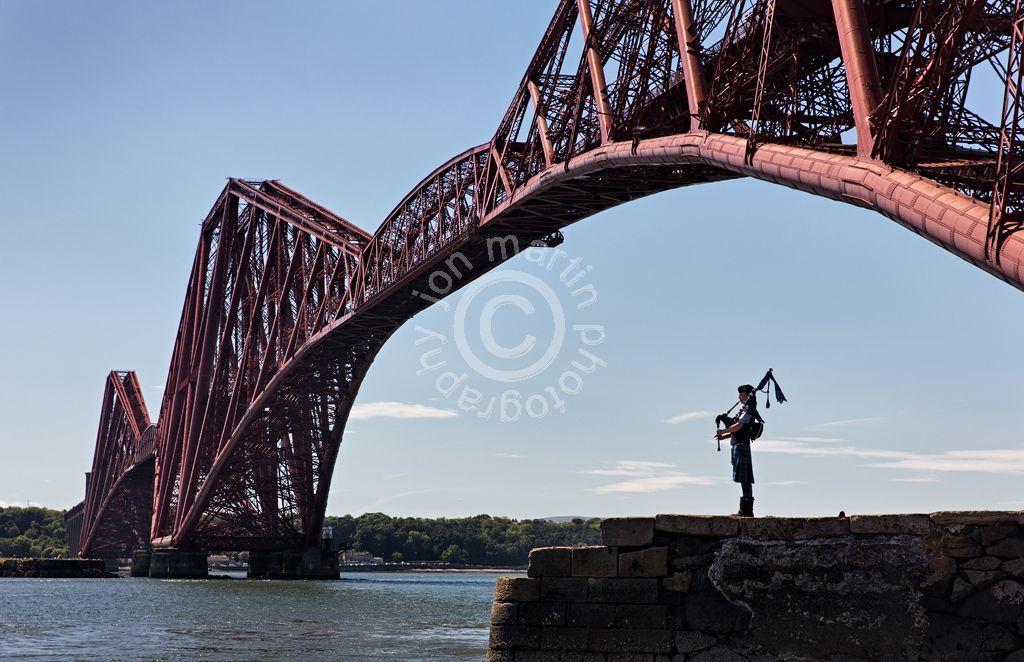 Bagpipe Player at the Forth Bridge, Edinburgh
