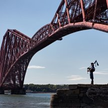 Bagpipe Player at the Forth Bridge, Edinburgh