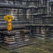Monk in Rain at Angkor Wat for Home Page