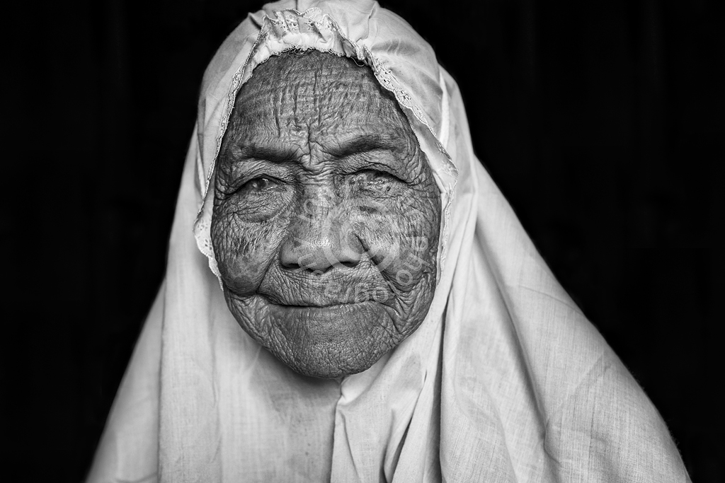 Old Lady in Traditional Headdress