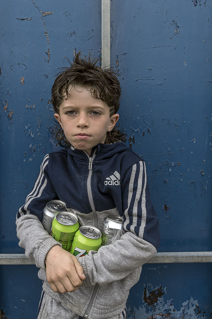 Boy with Four Cans, Limerick, Ireland 2019