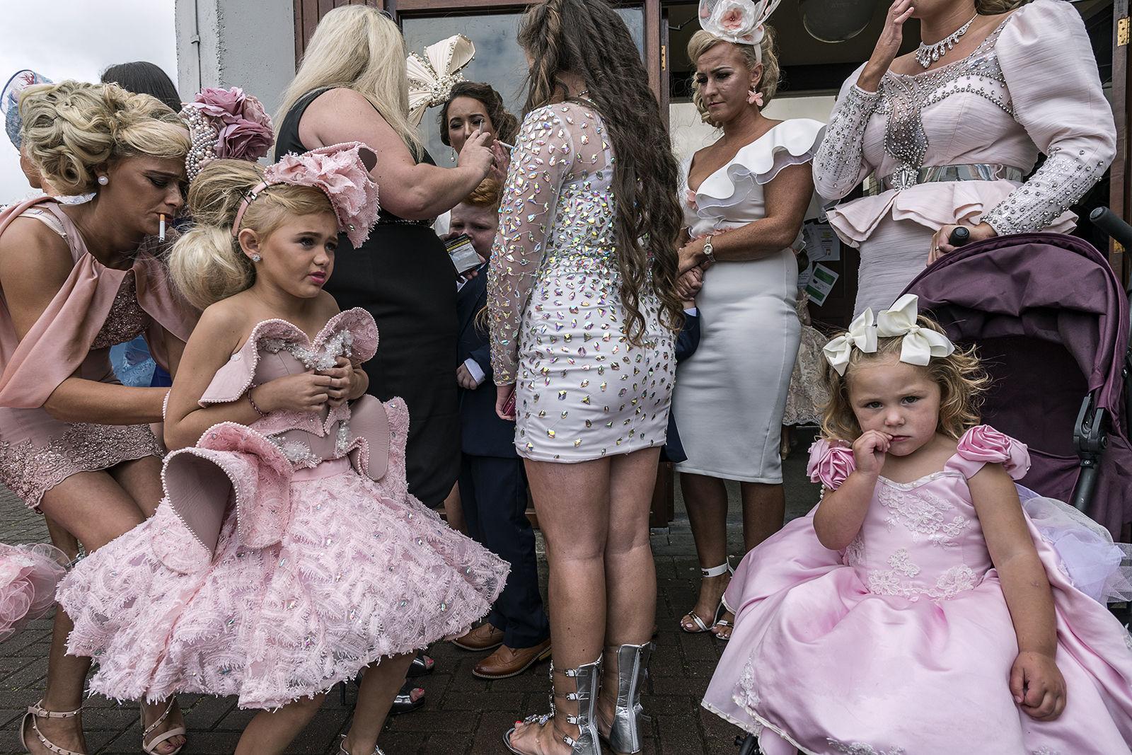 Women and girls gather outside church after an Irish Traveller wedding. Wexford, Ireland 2019