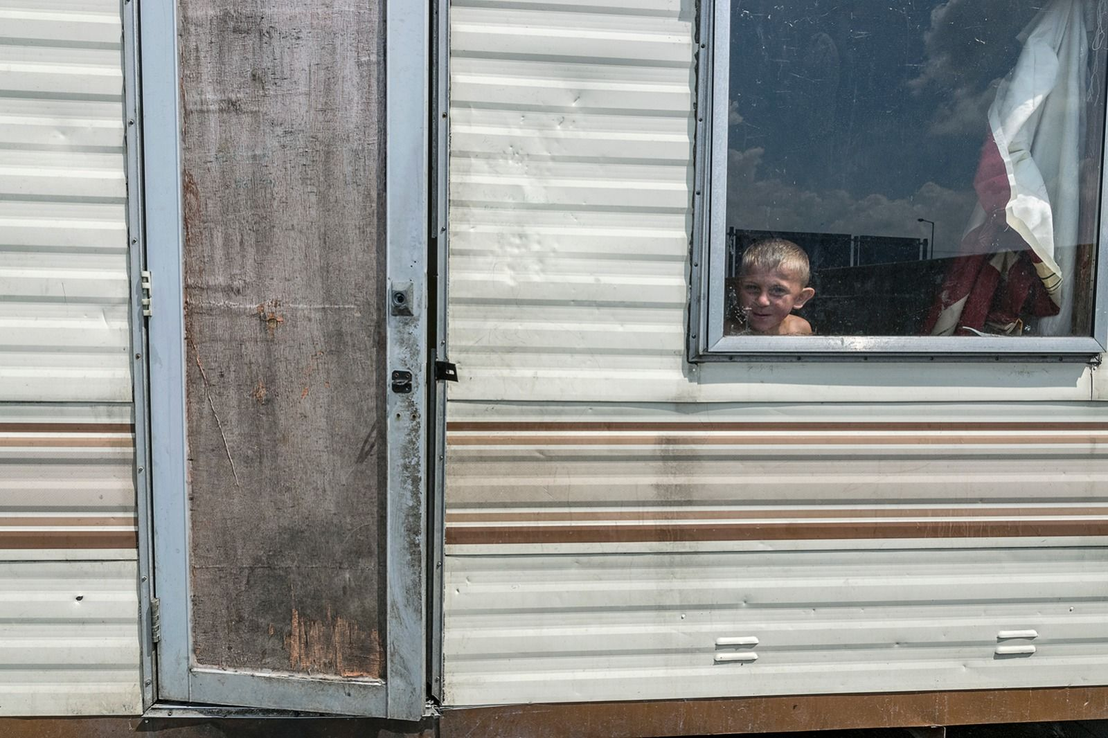 Boy in Window, Tipperary, Ireland 2018