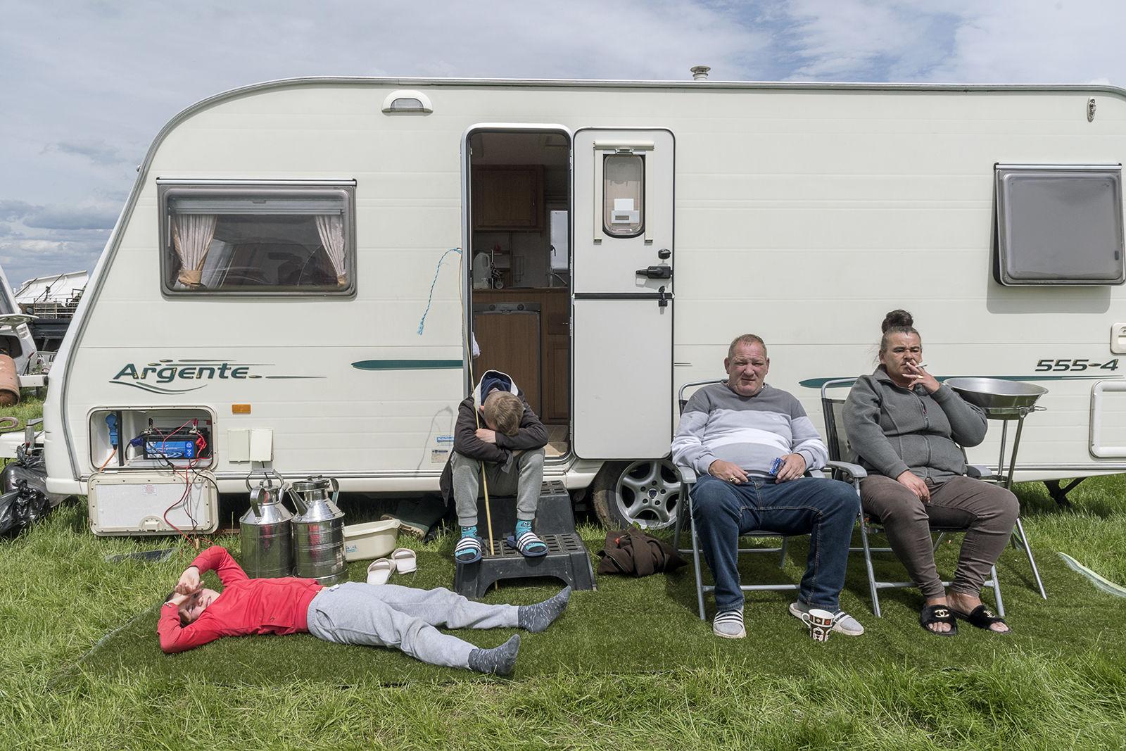 Family on Artificial Grass, Appleby Horse Fair, UK 2019