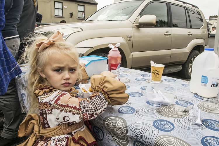 Ann eating chips at Ballinasloe Fair, Galway, Ireland 2018