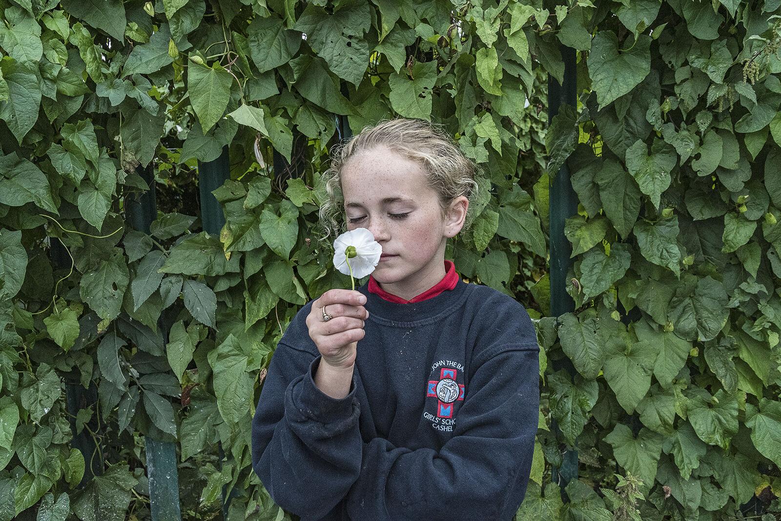 Kaitlyn smelling Flower, Tipperary, Ireland 2019