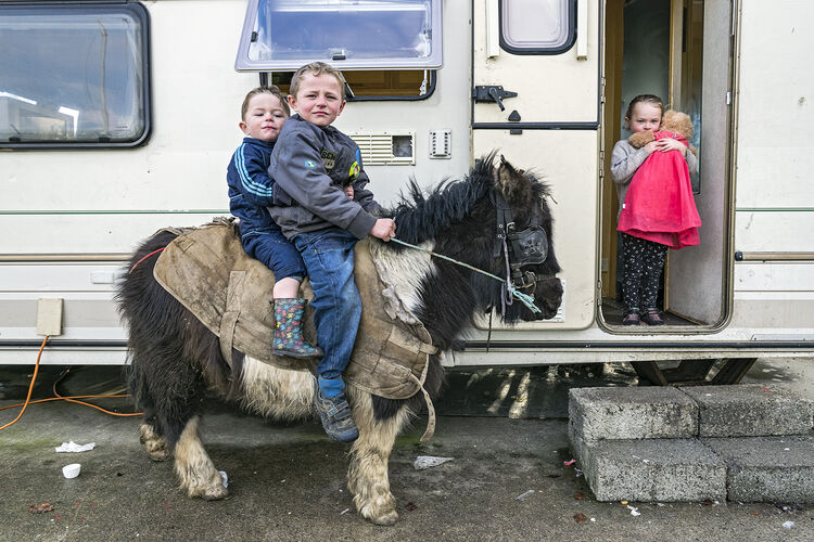Michael and Pa on pony and Nikita with doll, roadside campsite, Tipperary, Ireland 2019