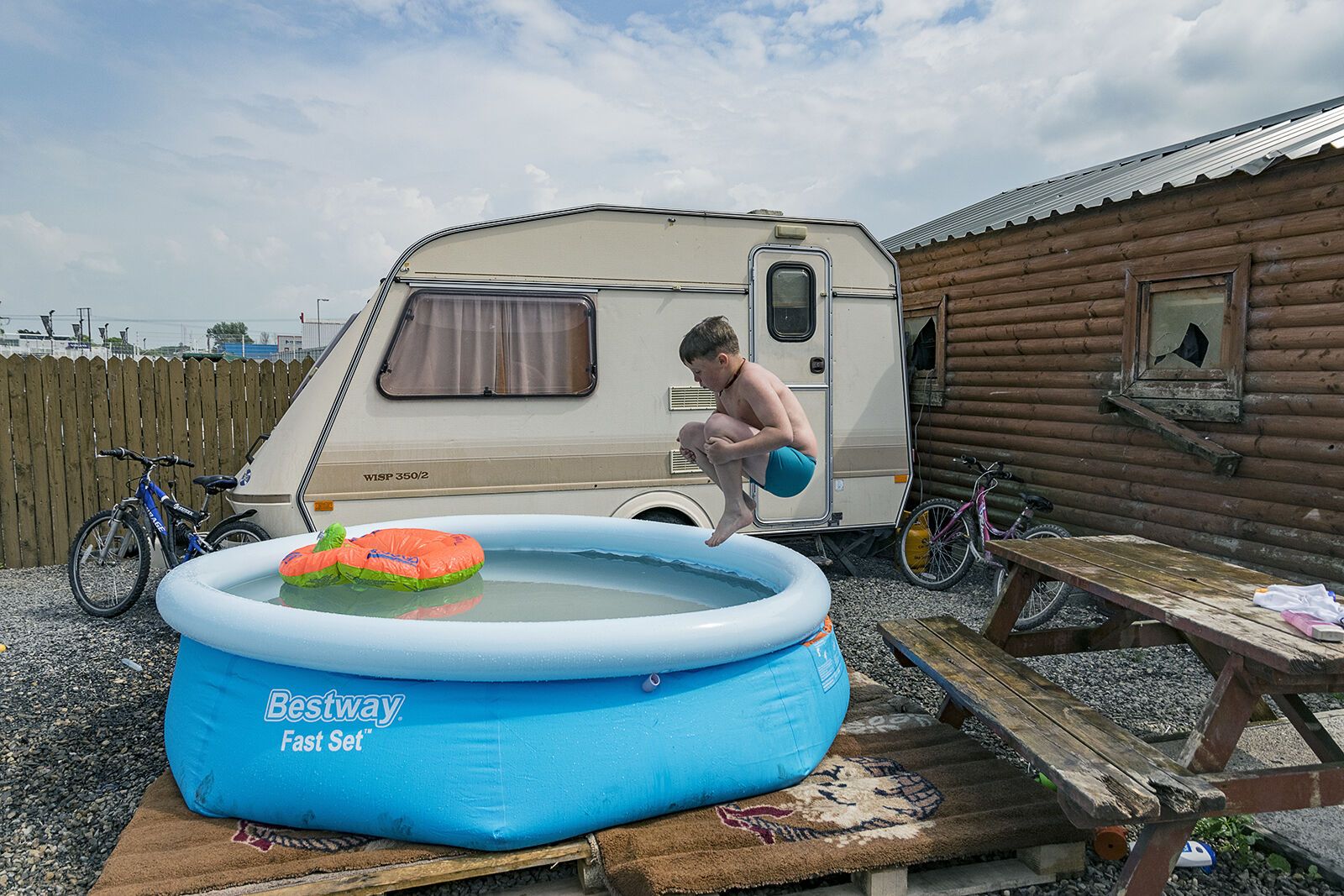 Mikey jumps into the pool during a rare heatwave, Limerick, Ireland 2018