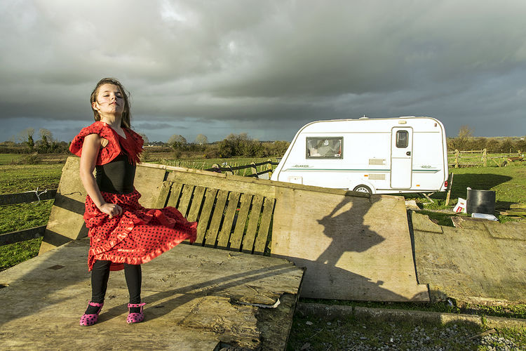 Nikita trying her new flamenco dress, roadside campsite, Tipperary, Ireland 2019