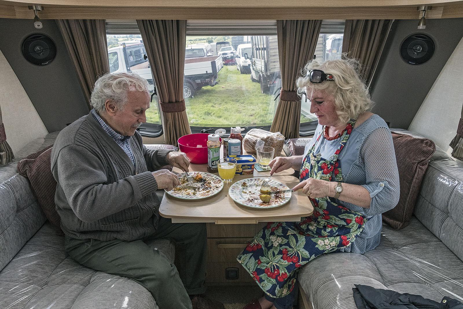 Romanichal Couple eating Dinner, Appleby Horse Fair, UK 2019
