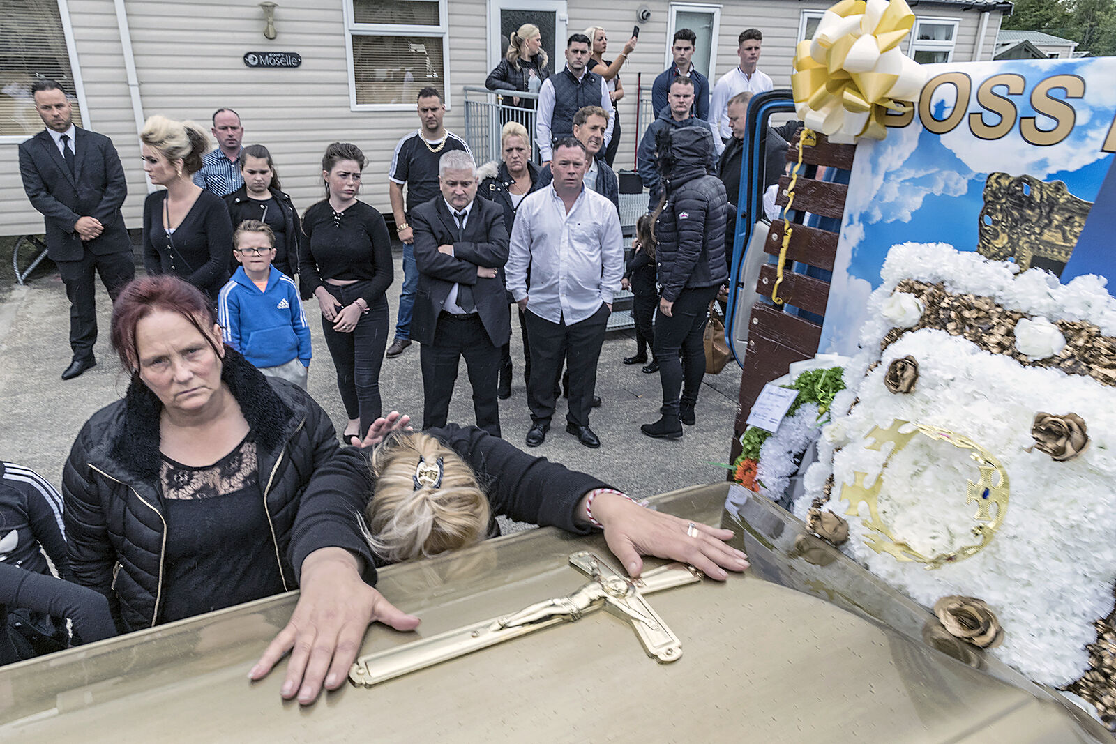 Wife at her late husband's coffin, Limerick, Ireland 2019
