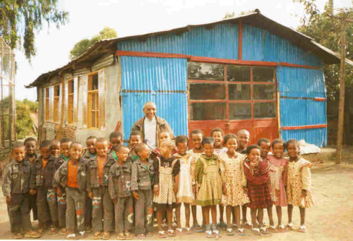 Mr Worku with Grade 1 in their uniforms (2007)