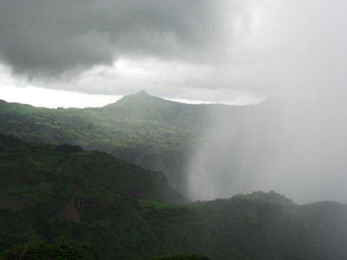 a storm sweeps up towards the escarpment