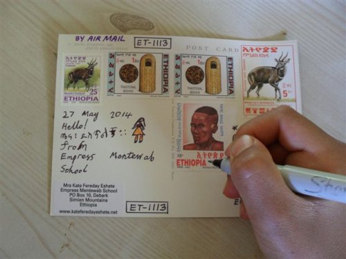 writing a Postcrossing postcard