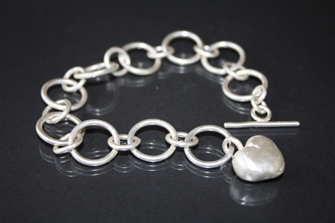 Handcrafted solid silver heart bracelet