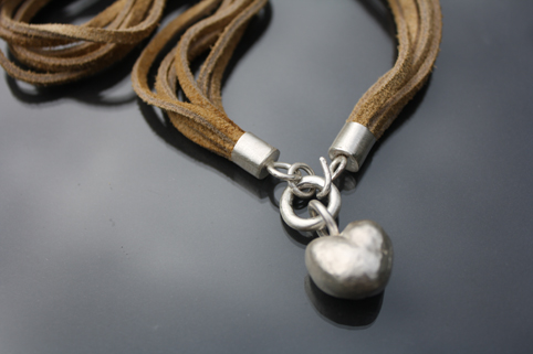 Solid silver cast necklace on leather