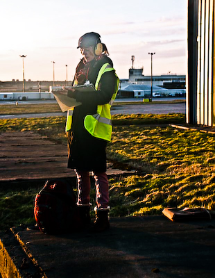 On the runway in my safety gear in collaboration with Canadian Holding Company at Aberdeen Heliport
