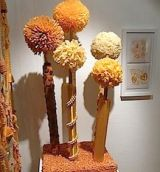 Pompoms created with common household materials by Lilla Wren