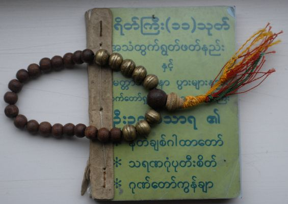 green prayer book and beads 2
