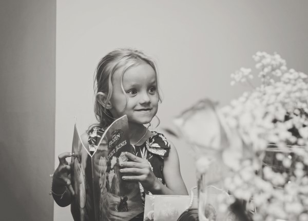 A small, excited wedding guest